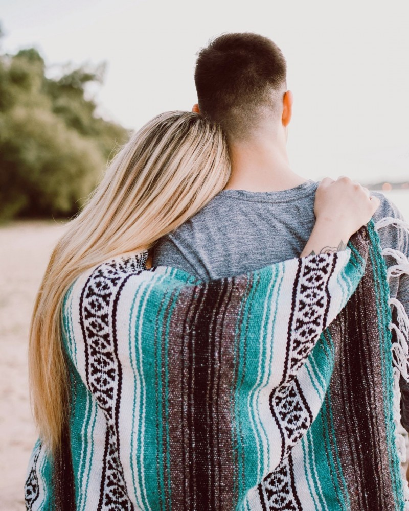 couple hugging with blanket