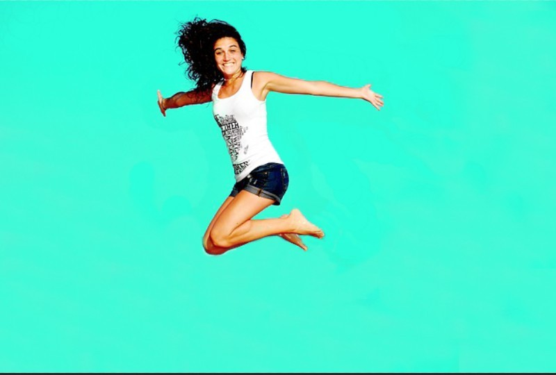 girl jumping on a green background