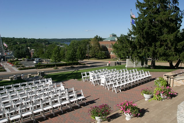 The Perfect Wedding Venue - Outdoor Reception with White Chairs
